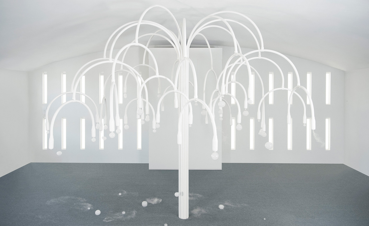 COS and Studio Swine have recreated their mesmerising Salone del Mobile installation inside Miami's art deco Temple House. On the opposite end of the spectrum to the darkened space that hosted the Italian version, the US iteration has been reimagined in white COS minimalism, overlooked by tropical palms.