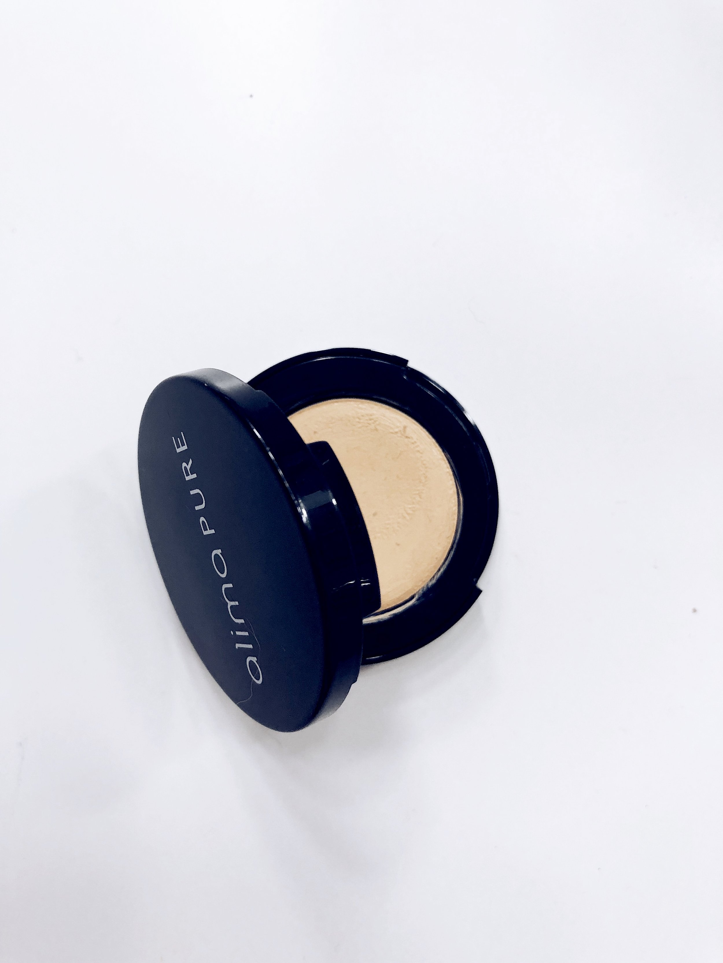 Alima Pure Cream Concealer - $28 - Here's the quick SCORECARD breakdown. Each question is rated on a scale of 1 to 5, 5 being the best:1. How do the ingredients look (EWG.org ratings)?- 4: Looks good except for the possibly inclusion of Ultramarines- see below. *Gluten-free2. How effective is the coverage?- 4: As solid medium coverage that starts buttery in the pan and offers a velvety finish on the skin. 10 shades available.3. Does it look natural?- 4: It does sit a bit on top of the skin. The velvety finish feels like it sets itself.4. Does it play well with other products?- 3: This can be trickier for dry skin types. You may want to use a bit of moisturizer.5. Does it last all day?- 4: I don't find I have to reapply in the middle of the day. Not much setting involved either, per above.6. Is it non-irritating?- 5: No problems here!7. How conscious is the brand? Cruelty free, sustainable, etc.- 4FINAL SCORE:28/35