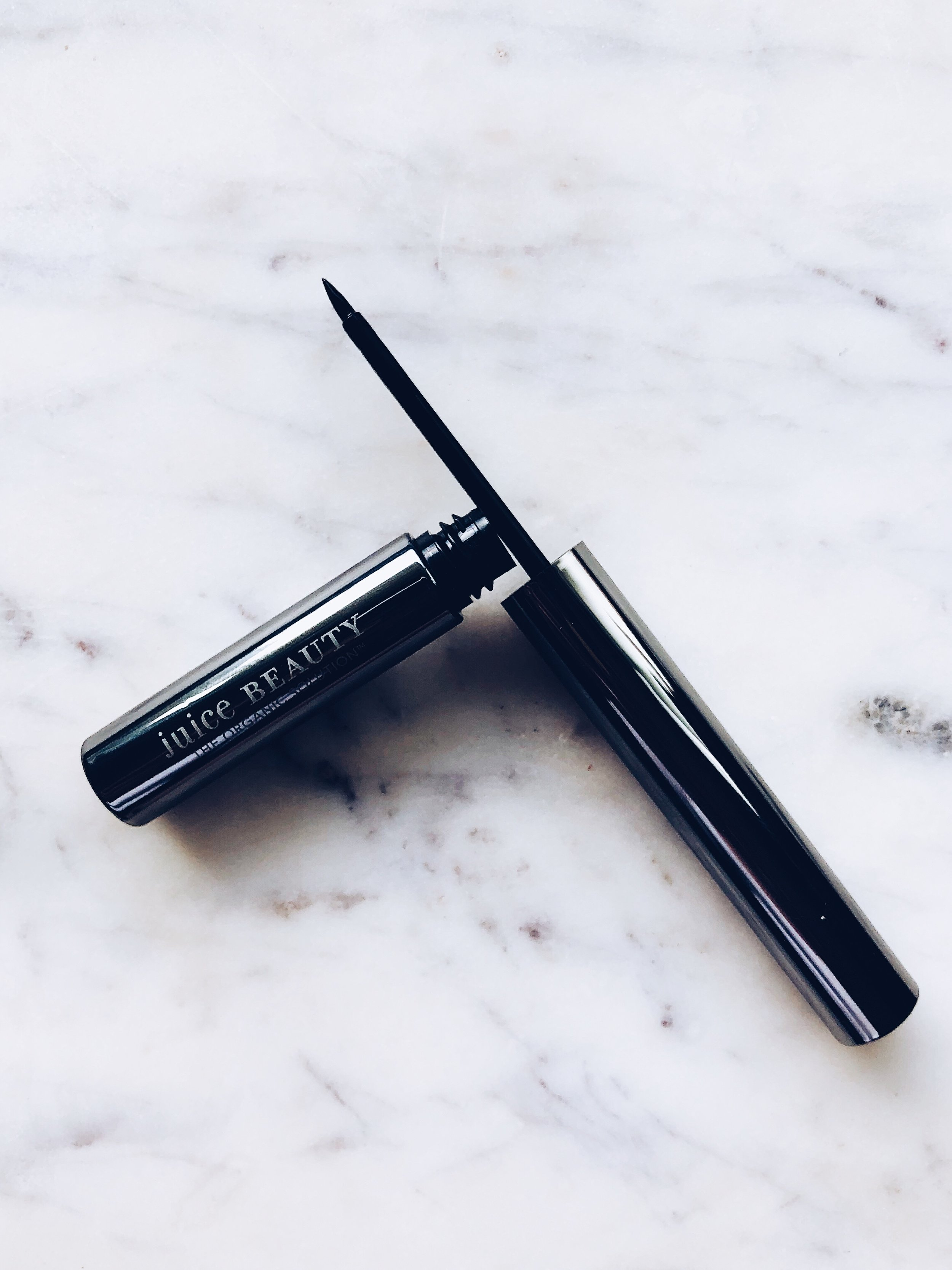 Juice Beauty Phyto-Pigments Liquid Line & Define Eyeliner- $24 - Here's the quick SCORECARD breakdown. Each question is rated on a scale of 1 to 5, 5 being the best:1. How do the ingredients look (EWG.org ratings)?- 4: Looking good! One iffy ingredient, see below.2. How is the color payoff? 5: Color glides on and is super saturated!3. Does it apply seamlessly?- 4: I found this liquid liner to be super easy on application. No pulling and when I went over the first coat, nothing budged or slid off.4. Does it last?- 4: I set and primed the lid. This liner stuck around almost all day!5. Does it build?- 4: Yes! You can keep a thin line OR exaggerate and thicken things without losing any sharp lines.6. Is this non-irritating?- 5: No breakouts here!7. How conscious is the brand? Cruelty free, sustainable, etc.- 4: Super close to perfect.FINAL SCORE:30/35