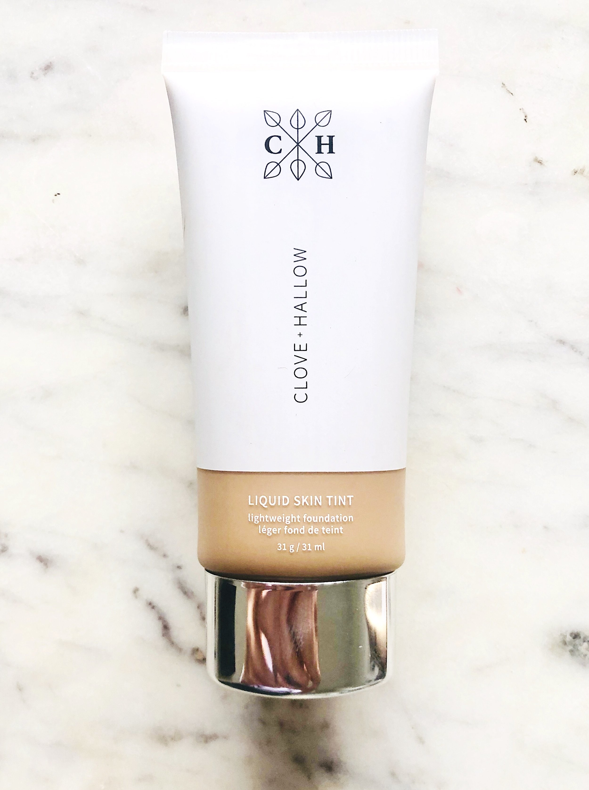 "Clove + Hallow Liquid Skin Tint- $26.00 - Here's the quick SCORECARD breakdown. Each question is rated on a scale of 1 to 5, 5 being the best:1. How do the ingredients look (EWG.org ratings)?- 3: Lots of ingredients at ""2"" and ""3."" Three of primary concern: Dimethicone, Potassium Sorbate, and Sodium Benzoate, which could potentially be irritating and also not eco-friendly (Dimethicone specifically).2. How is coverage?- 5: Nailed it on performance here! The brand says you will get a ""demi-matte, lightweight medium coverage,"" and they deliver on their promise. Skin looks like skin!3. Does it last?- 5: Oh yea. This was super impressive. I tried it with and without setting. In both instances, the product still looked fresh at the end of the day.4. Is it non-irritating?- 3: Review the ingredients list below. Be informed, not afraid! Definitely dig a bit further if you have sensitive skin!5. Does it build and blend well?- 5: Again, nailed it on coverage and overall performance. I wore this with several layers and saw no streaking of odd settling into pores or fine lines.6. Is the shade range inclusive?- 4: 12 shades is respectable!7. How conscious is the brand? 3- I'm still waiting to hear back on packaging which, right now, looks and feels like plastic. It is however cruelty-free and vegan, so that's a plus!FINAL SCORE:28/35"