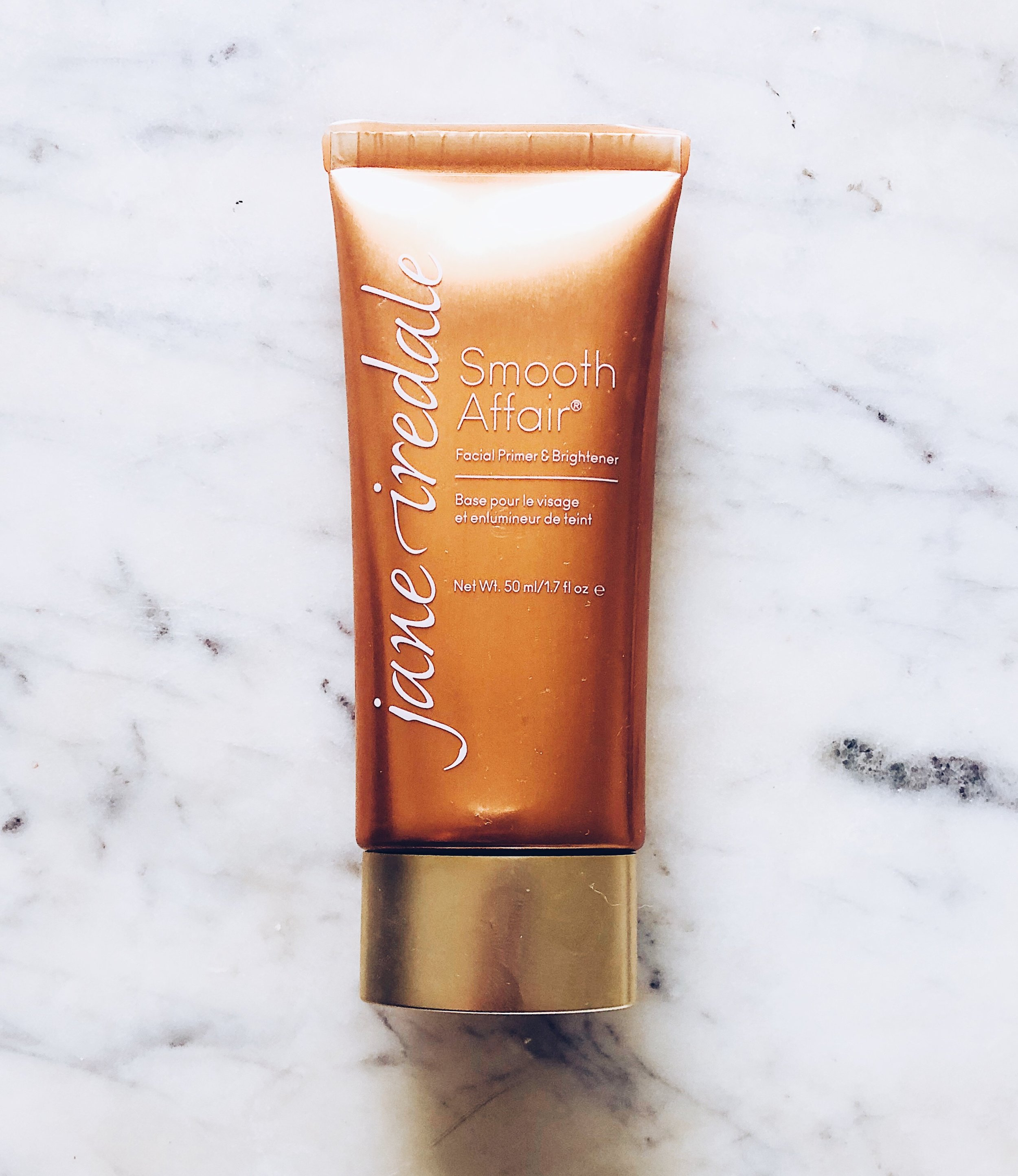 Jane Iredale Smooth Affair Primer & Brightener- $50.00 - Here's the quick SCORECARD breakdown. Each question is rated on a scale of 1 to 5, 5 being the best:1. How do the ingredients look/what's inside?- 3: Dimethicone is in here, and a few other 'iffy' ingredients. More below!2. Does it smooth and minimize pores?- 3: Smoothing? Yes. Pore minimizing? Not so much for me. See a close-up demo in the video. It definitely brightened though!3. Staying Power: Does it last all day or feel greasy?- 3: It wasn't greasy feeling at all, but I didn't see any massive benefits from wearing this in terms of helping foundations last longer.4. Is it non-irritating?- 3: It didn't irritate my skin, but does contain ingredients that could be irritating to sensitive skin types.5. Does it build and blend well?- 5: Absolutely. I had no issues here!6. Is this a consciously-created product?- 3: it is cruelty-free, but I've yet to hear back from the brand on what looks to be plastic packaging. I'll update as soon as I hear!7. Does it do what it says it will do? 3- I speak more to this in the video review, but I didn't see the anti-aging benefits or skin firming. It fell a bit short.FINAL SCORE:20/30