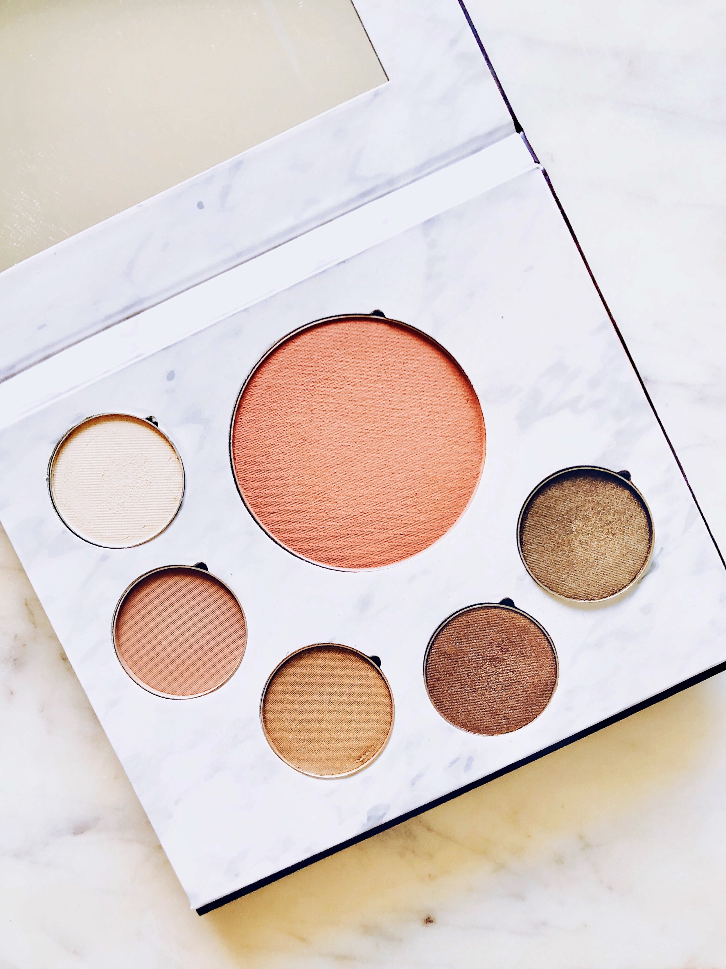 Fitglow Beauty Nights Makeup Palette- $69.00: - Here's the quick SCORECARD breakdown. Each question is rated on a scale of 1 to 5, 5being the best:1. How do the ingredients look? What's inside?- Great! See below for any call outs.2. How is pigment and color payoff?- 5: Wow. The color payoff is amazing, truly.3. How is application?- 5: This shadow applies like a dream. Very little fallout and blends in well.4. Is it non-irritating?- 5: No issues here!5. Does it crease?- 4: I experienced limited to no creasing with this shadow, even without primer. I am so impressed!6. Does the color last all day? 5- Yes. The full-day wear tests were SO successful!7. Is this a consciously-created product?- 4: Vegan, cruelty-free, silicone-free, recyclable (EXCEPT for the mirror unfortunately).FINAL SCORE:28/30