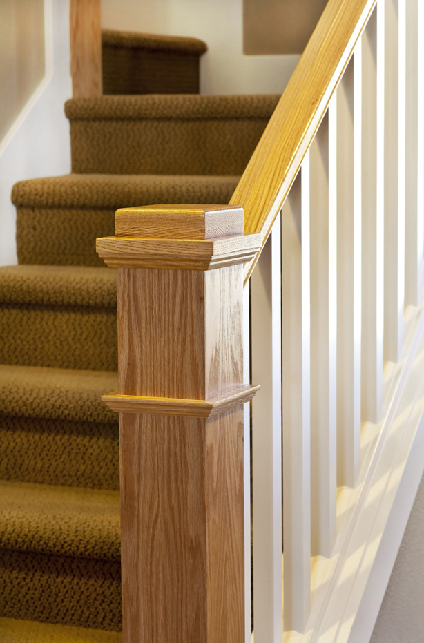 "Primed 5360 Square balusters and a 4091 Red Oak newel grace a carpeted ""box flight"" staircase."