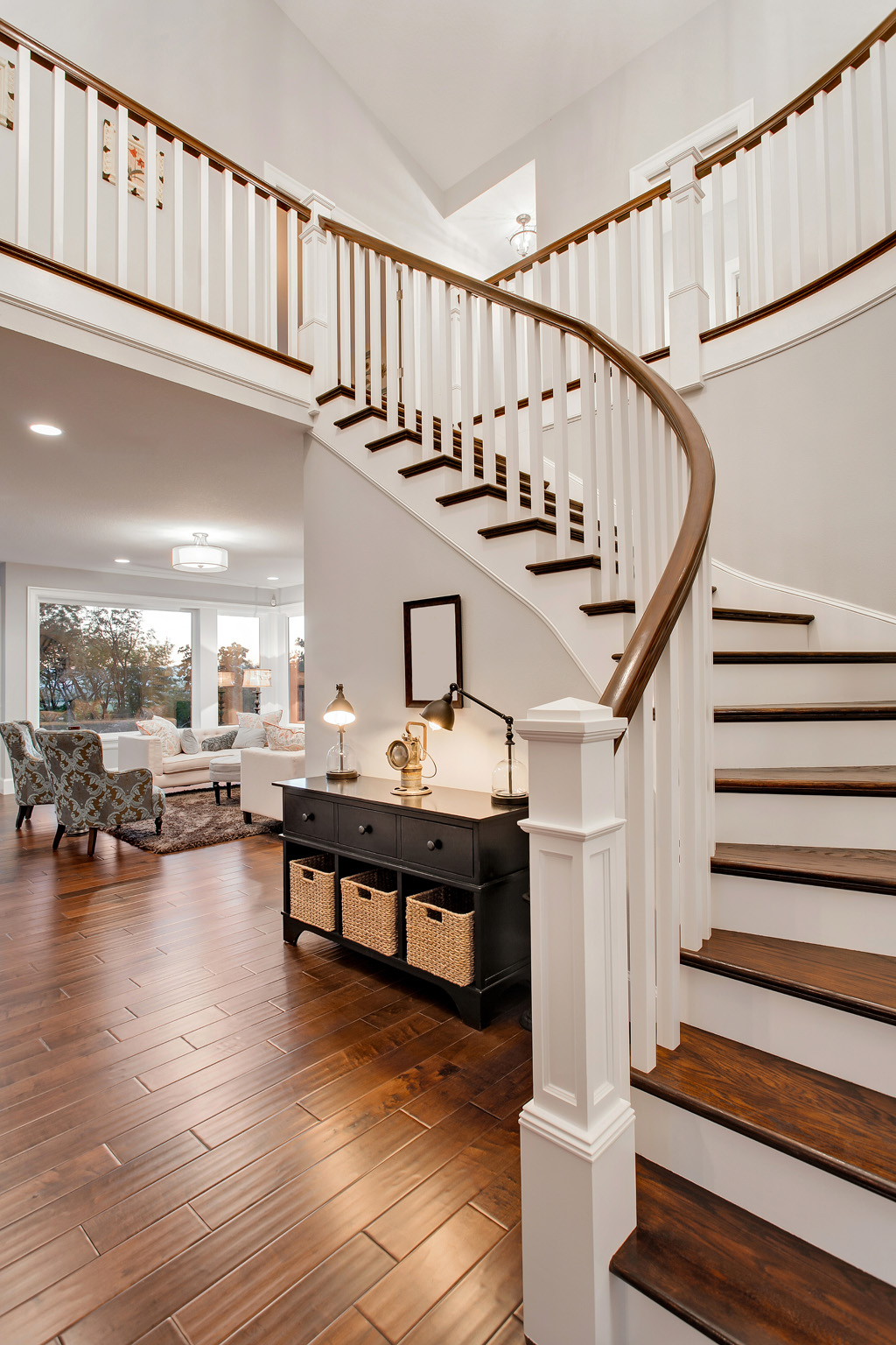 Primed 5060 balusters, 6210 Bending Rail bring and custom box newels lend beautiful lines to this open staircase.