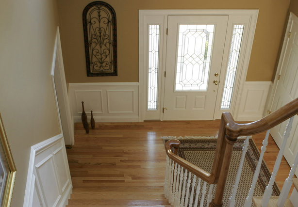 "5235 Primed balusters, 6010 Oak handrail and 8503 Red Oak treads provide classic detail to this ""L"" shaped open staircase."