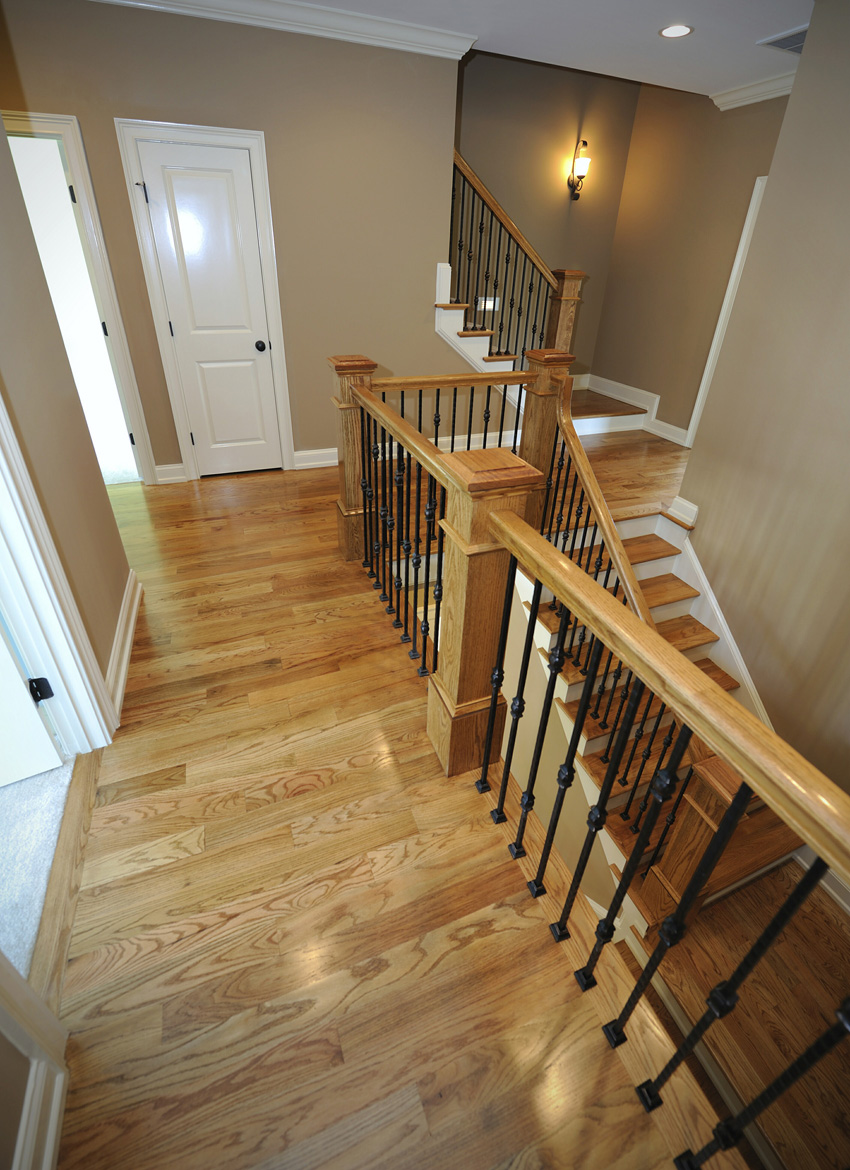 Our Roma baluster series, along with 4095 Red Oak newels offer the look of strength and beauty to this staircase.