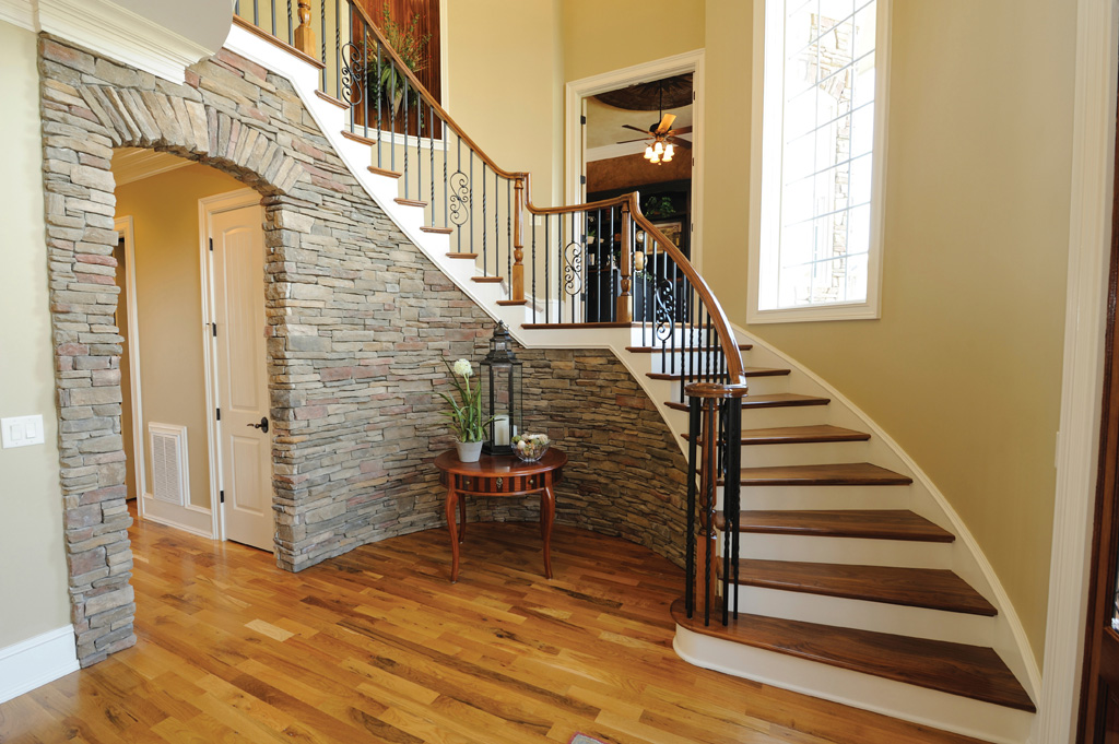 "Metal 5/8"" balusters bring depth and detail to this staircase leading to a foyer."