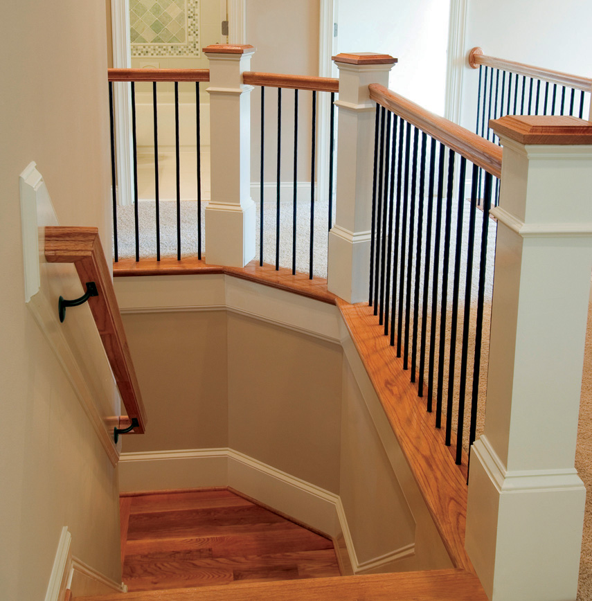 4095 Poplar Box Newels with oak caps frame metal Double Twist TW2 balusters on a red oak staircase.