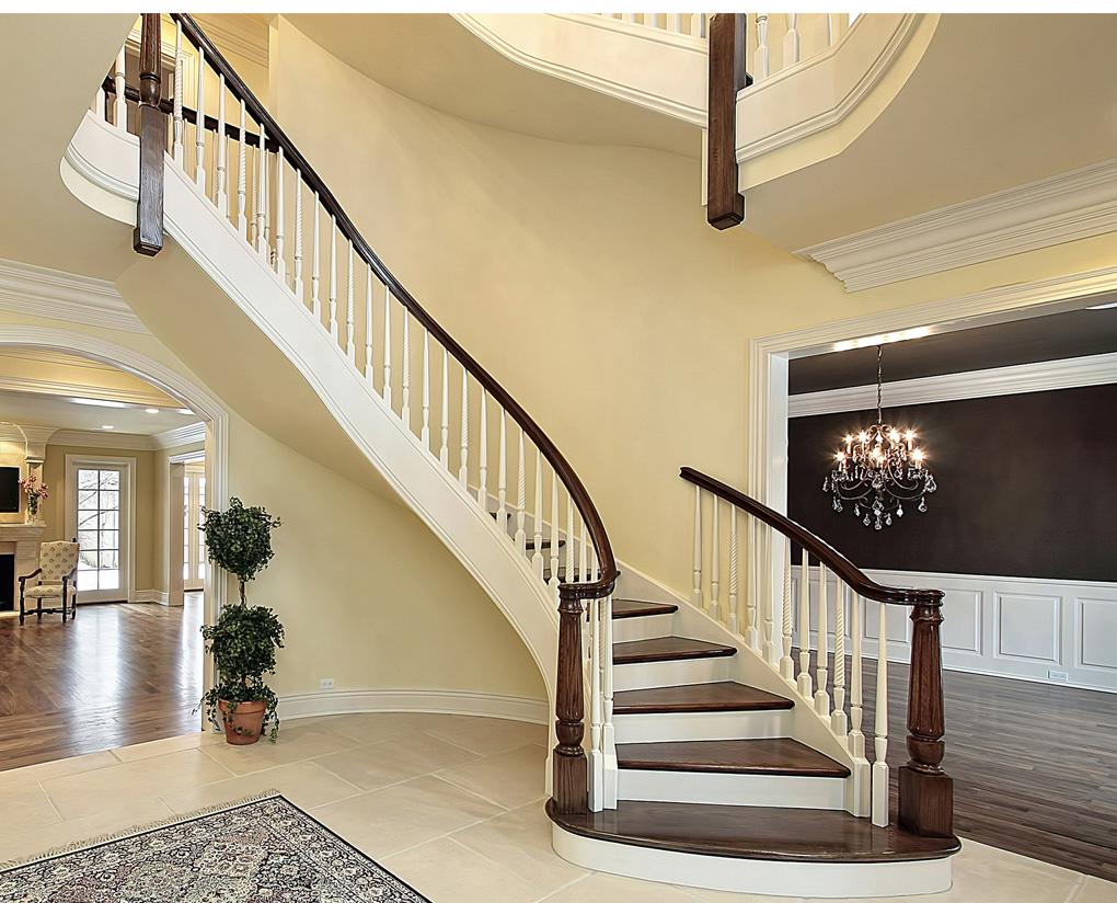 Over-sized turned newels accentuate a sleek, elegant curved staircase. We can replicate most any turned newel design.