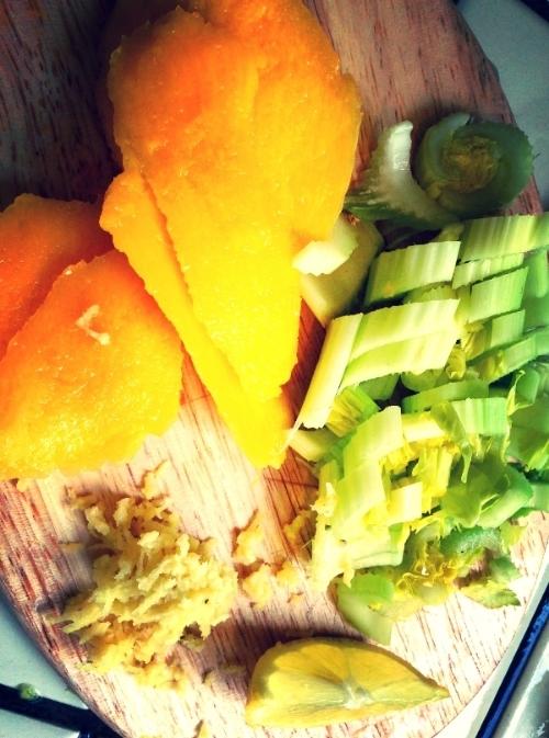 Prelude to a celery smoothie: mango, lemon, celery.