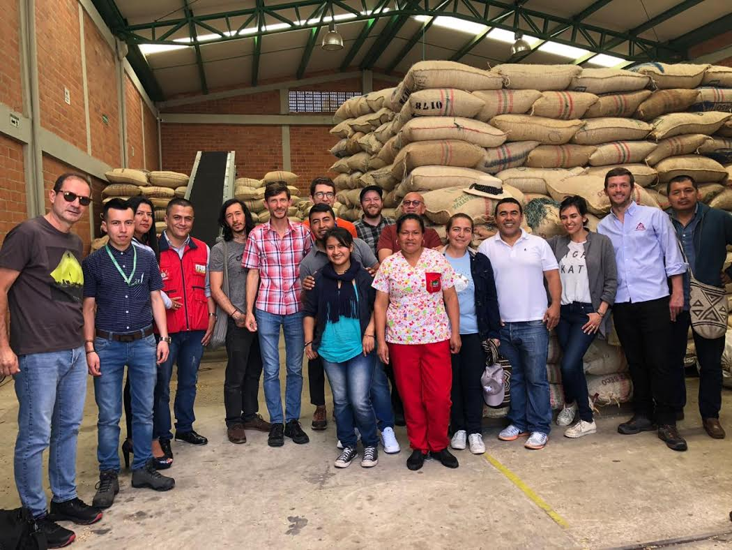 Members of CENCOIC, Coffee for Peace, and coffee buyers at CENCOIC's warehouse following our cupping.