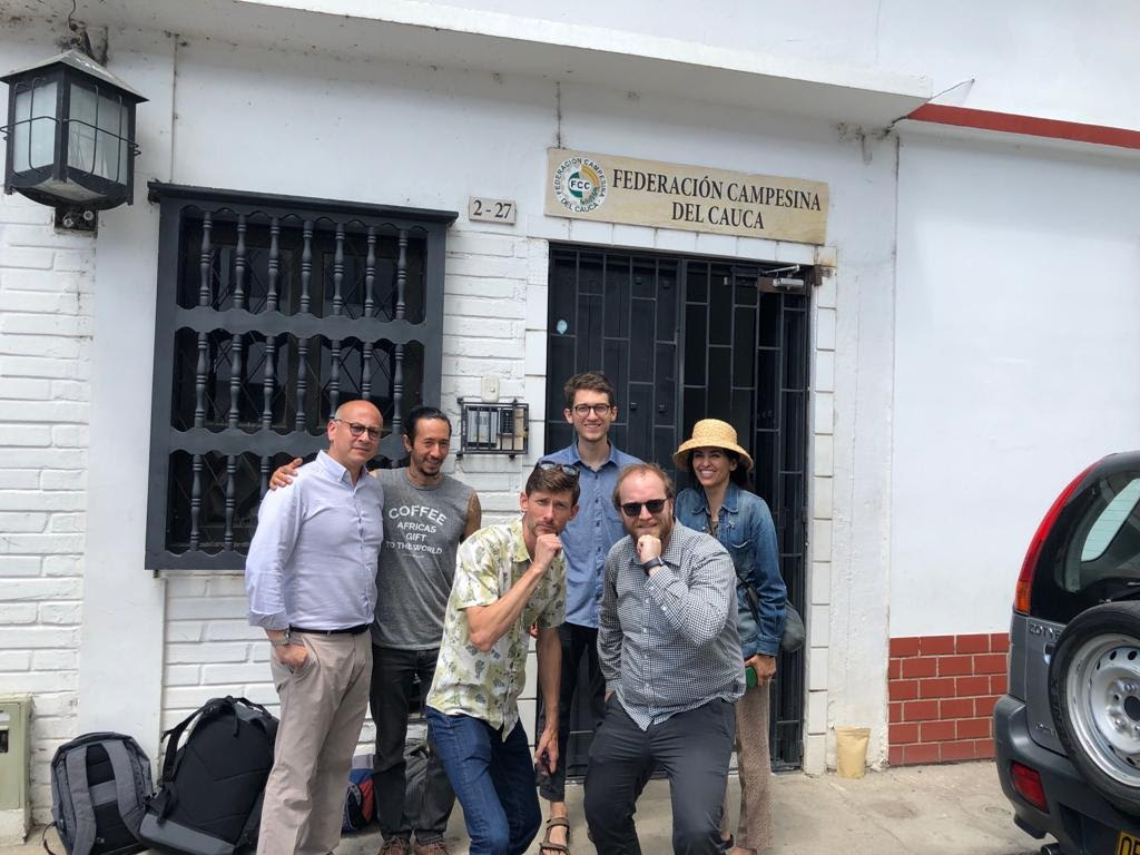 The crew of coffee buyers and members of Coffee for Peace, outside of FCC. Sparrows purchased a micro lot from producer Ever Castillo through this co-op.