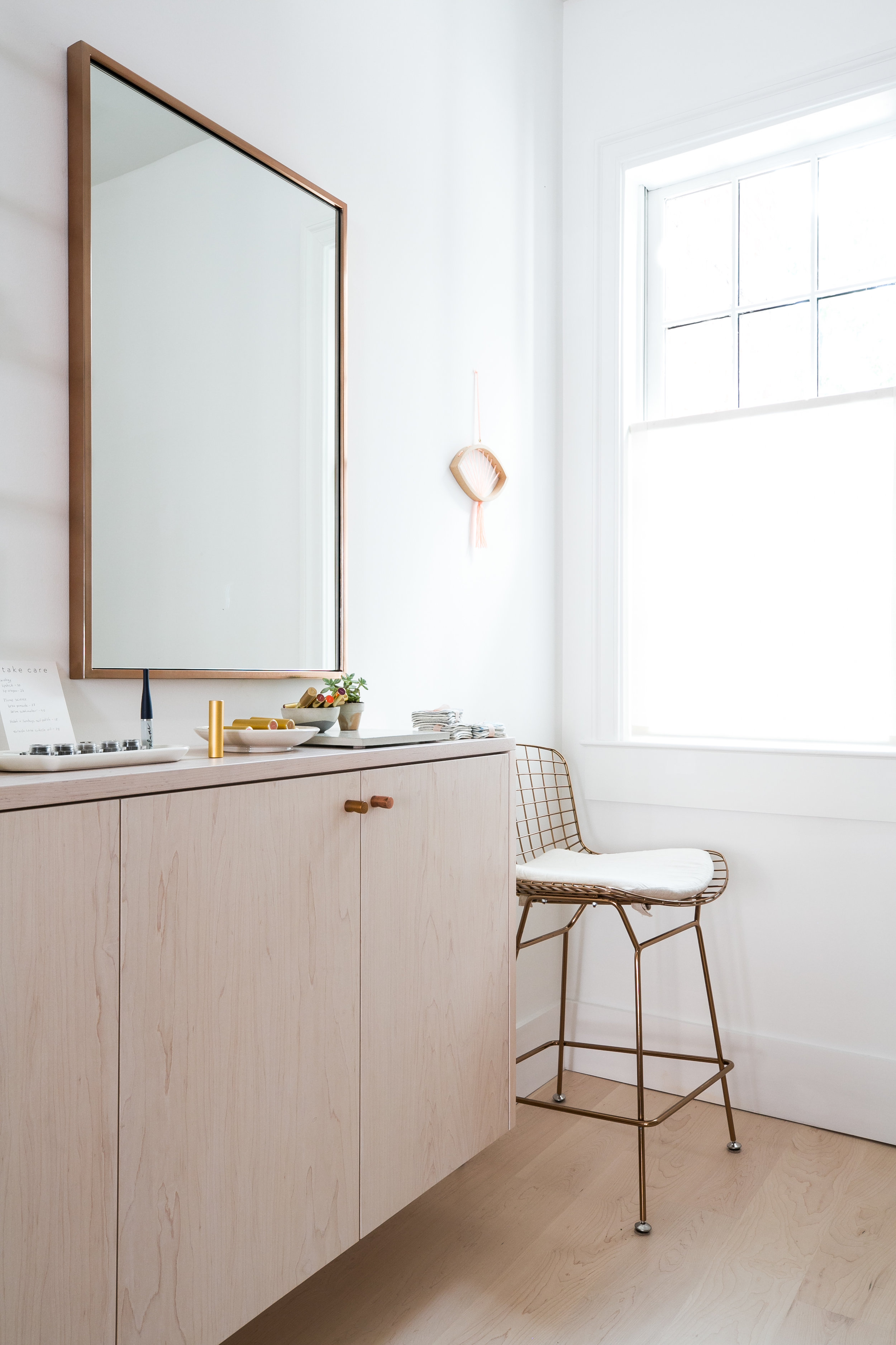 Wall-mount cabinet with adjustable shelves and copper knobs, constructed from birch plywood with whitewash stain and extra matte commercial polyurethane