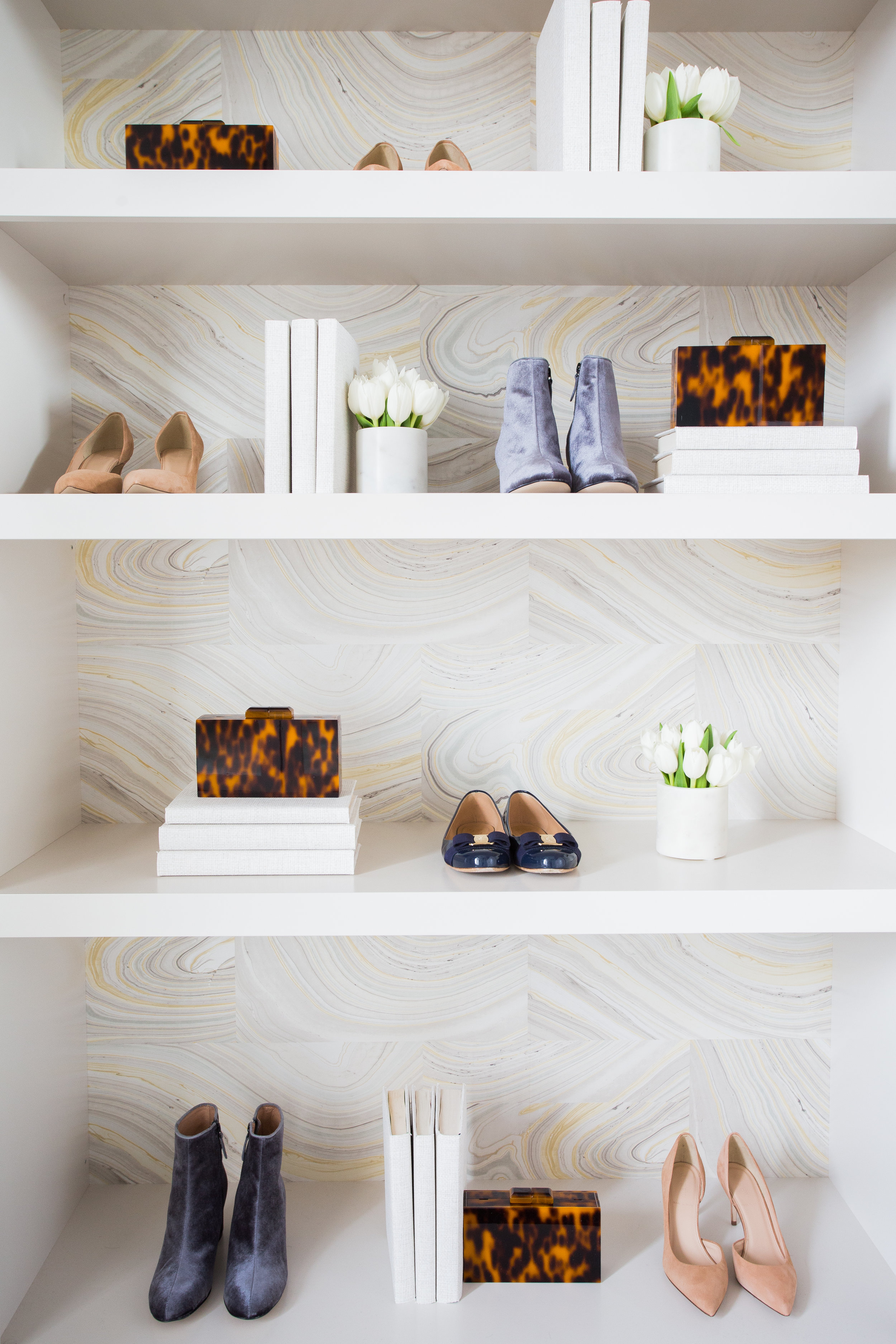 Custom walk-in master closet;birch plywood w/ solid five-piece drawer fronts, wall papered backing, adjustable shelving