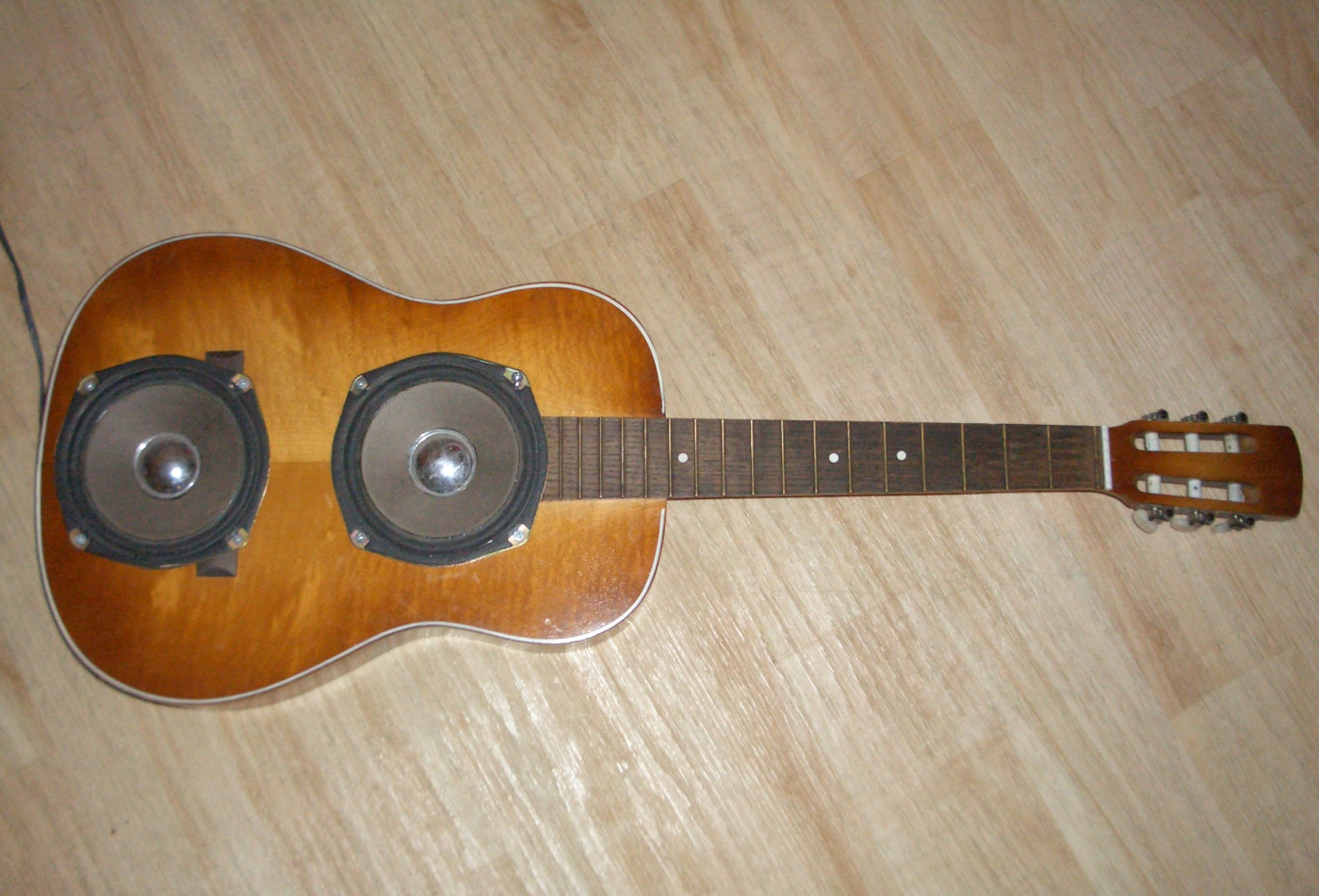 Repurpose your guitar. She deserves a second chance!