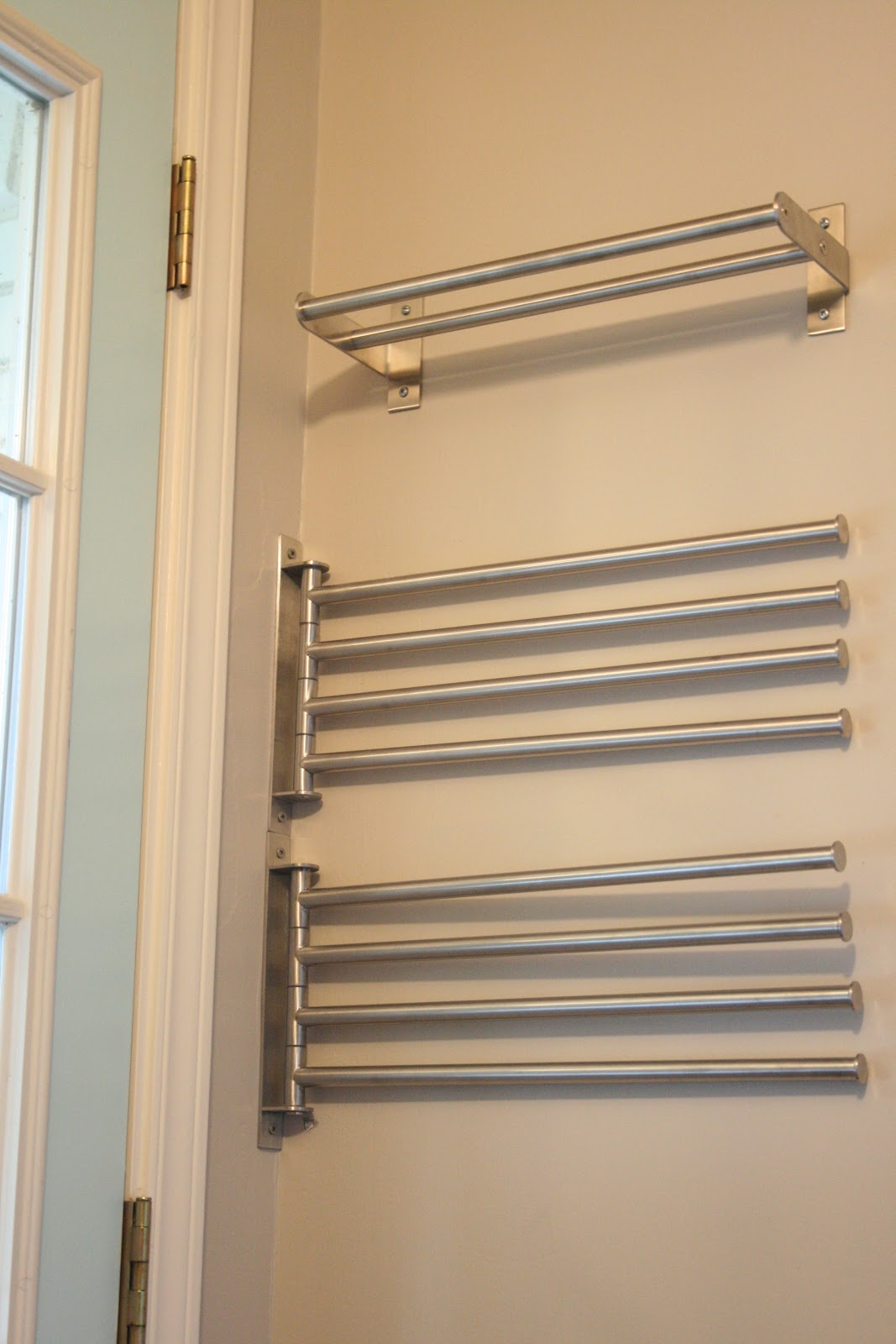 Towel racks from Ikea save space and can be hung behind doors and fanned out so towels dry fast.