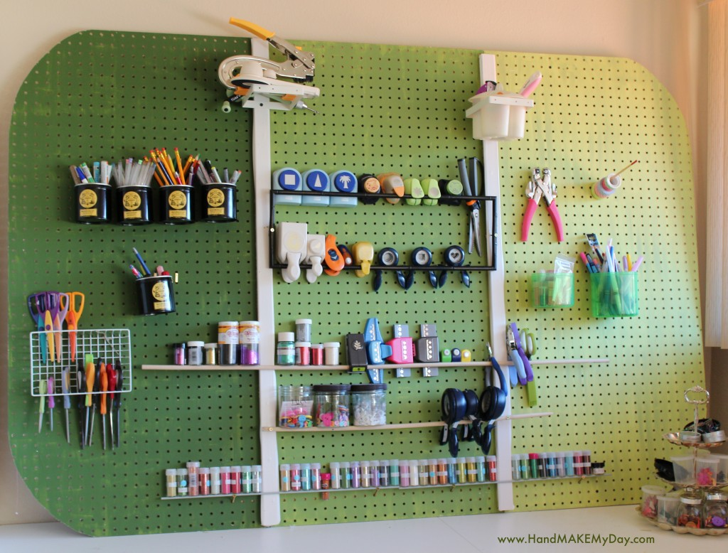 Perfect way to store the essentials of the craft room: pegboard + J-hooks