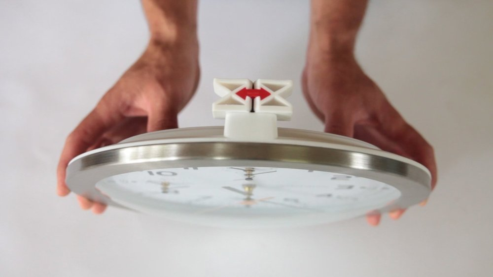 The YOUHANGIT device used to make the perfect mark for a clock, or anything you can hang on a wall.
