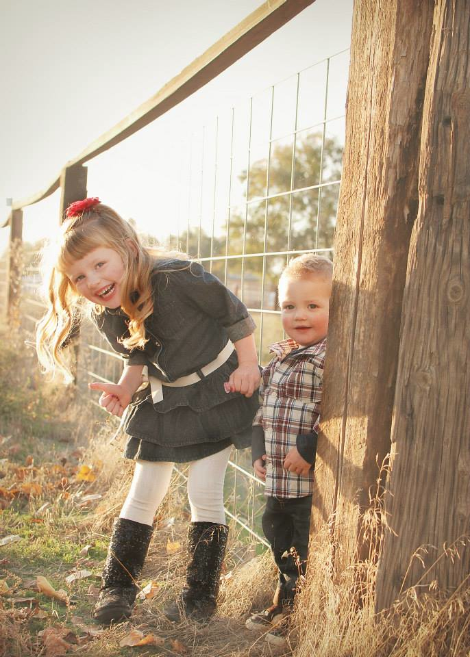 Delaney and Colton at the fence.jpg