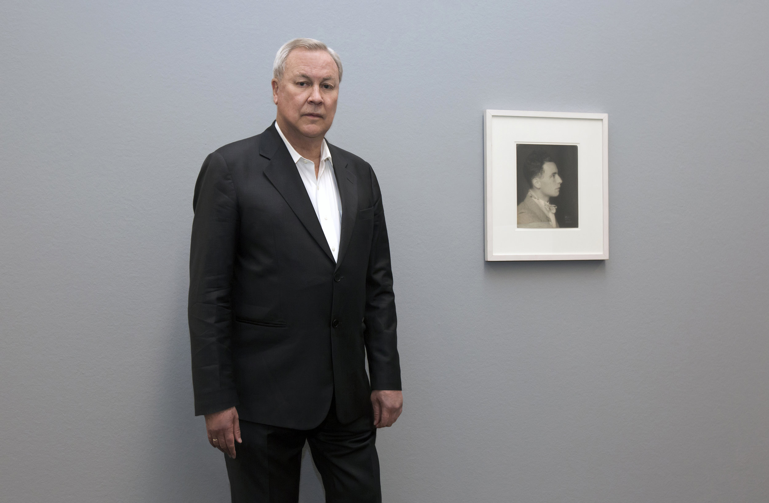 Robert Wilson at the Max Ernst Museum, with a photo of Louis Aragon by Man Ray (c.1925) - Photograph © Lucie Jansch