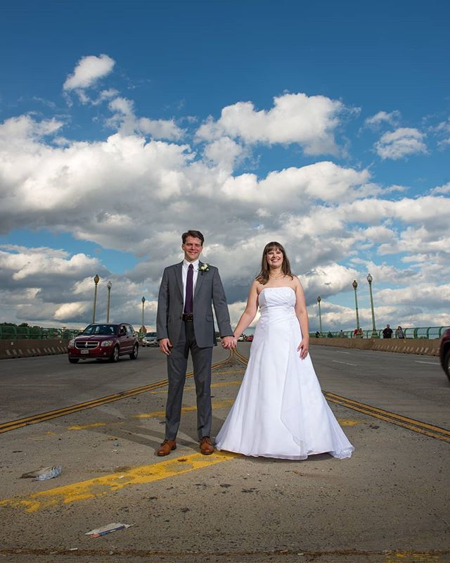 This couple stopped traffic in Arlington, Virginia. What a fun loving pair!  #keybridgemarriott #keybridge #virginiaweddingphotographer #dcweddingphotographer #yongnuoflash #nikonwedding #cloudywedding