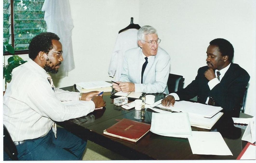 From Left: Dr. Frank Mosha, Director, Tropical Pesticide Research Institute (TPRI), Tanzania; Dr. Paul Capstick, Deputy Executive Director, African Biodiversity Institute (ABI)-GIDE; and Dr. Alfred Latigo, Executive Director, ABI-GIDE: Discussing a joint TPRI-ABI Impact Evaluation Project Funded by IDRC at GIDE Offices in Nairobi, Kenya (1995)
