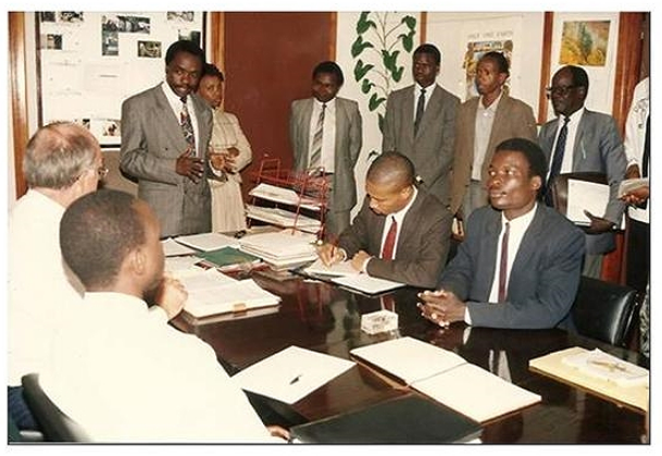 GIDE's PhD and Masters Program, 1994: Dr. Alfred Latigo, Executive Director & Chair of the Academic Panel  (standing)introducing students to Prof. Paul Muller (Late), Chairman Board of Directors(Seated, second on the left).