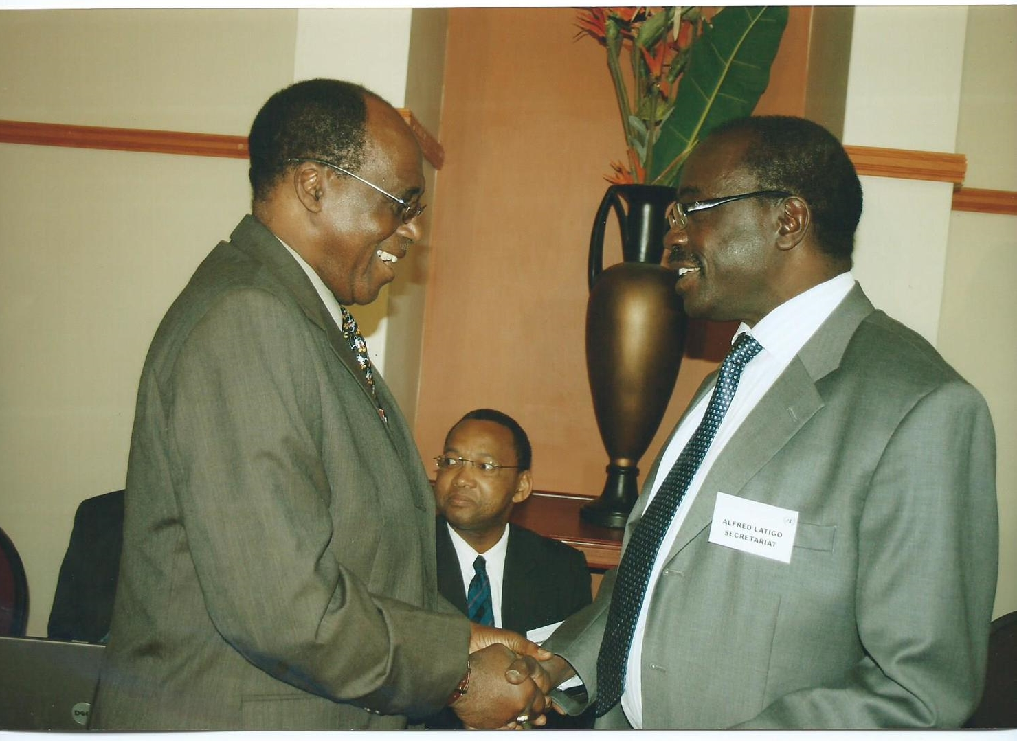 Prof. Ralph O Olaniyan, GIDE Board Director Chatting with Dr. Alfred Latigo at a Meeting in Johannesburg, South Africa, 2010. Prof. Olaniyan is the President of the R&G Economic Consultants LLC, USA a partner institution of GIDE.