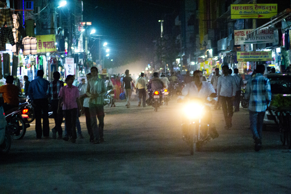 The hustle and bustle of the streets of India by night.