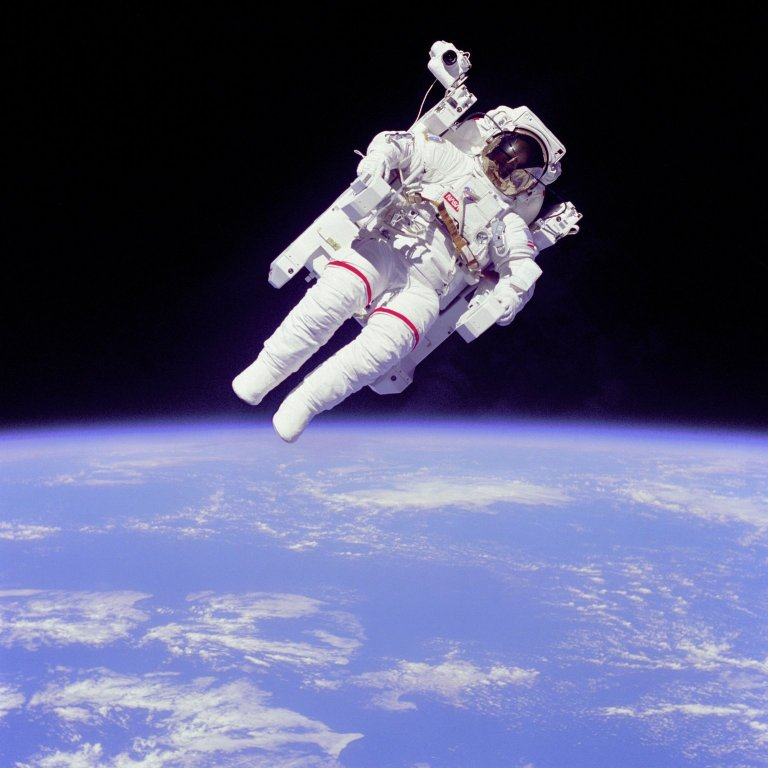 Astronaut Bruce McCandless II participates in an extravehicular activity a few meters away from the cabin of the shuttle Challenger during the STS-41B mission.