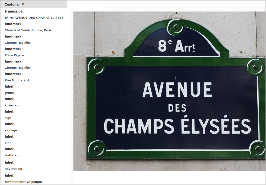 """In the example above the Vision API was able to transcribe the text, identify the landmark, and assign a number of labels to the image, including """"street sign"""" and """"commemorative plaque."""""""