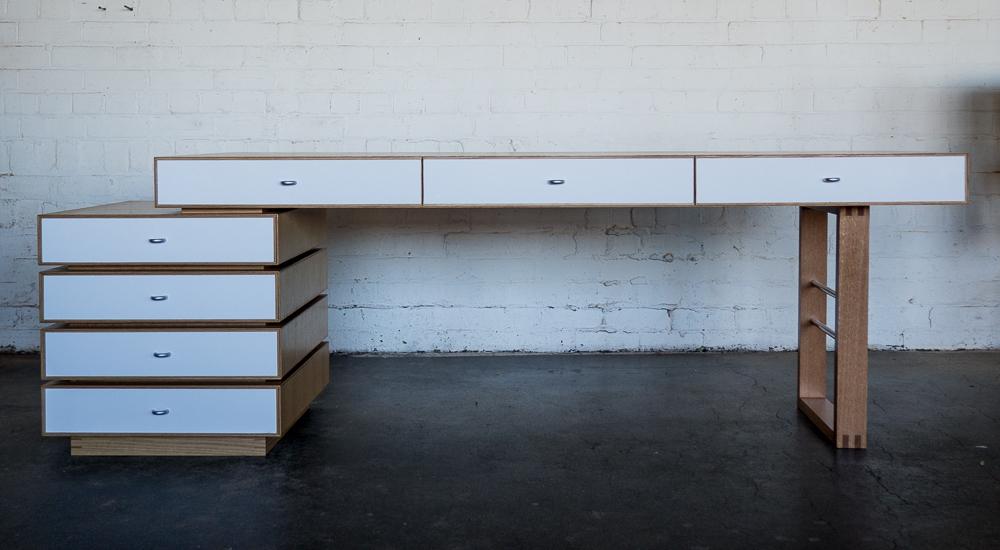 Regina's desk American White Oak veneer and solid, white gloss laminate.