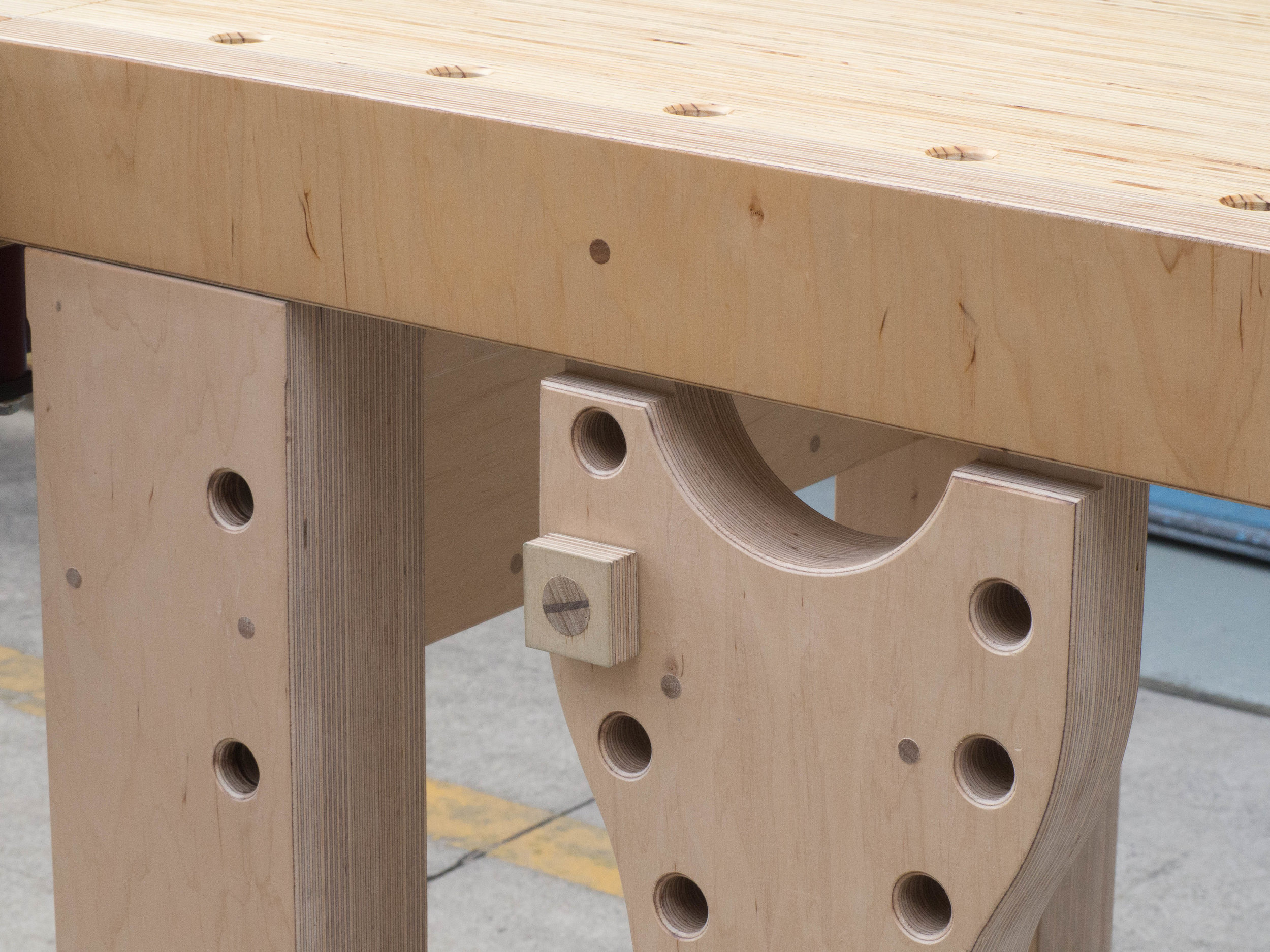 """Why round dog holes?  """" 1. Round dogs are easier to create... 2. Round dog holes play nicer with holdfasts... 3. Round dog holes have more accessories... 4. You can quickly make your own round dogs...""""  Christopher Schwarz The Workbench Design Book, 2010"""