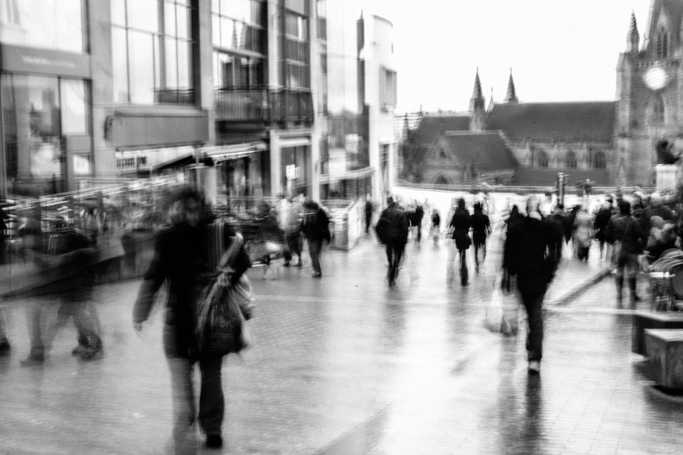 The reflections from the rain and the movement of the shoppers add to the atmosphere in this scene. Image copyright Katya Hall.