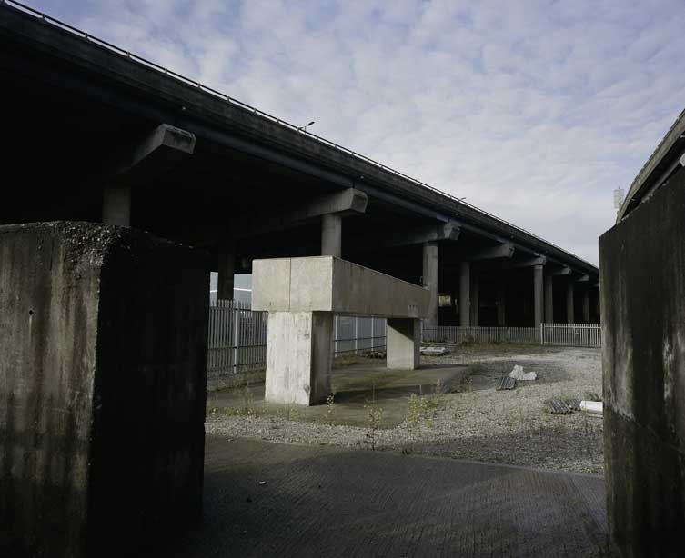 These obscure concrete henge like structures are dense concrete to supress the vibrations from the junction above.