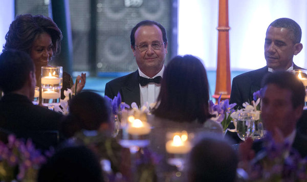 French President Francois Hollande (center), with first lady and President Obama, at Tuesday's state dinner. PABLO MARTINEZ MONSIVAIS / AP