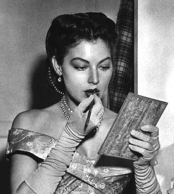 Ava Gardner & the very chic-est of compacts.  [Photograph by Ida Von Dee.]