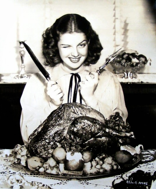 Rita Hayworth carves the bird.