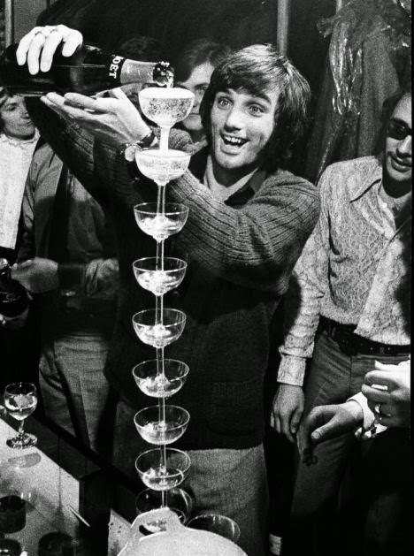 George Best & his signature champagne stack, 1968. (We won't tell you NOT to try this at home!)