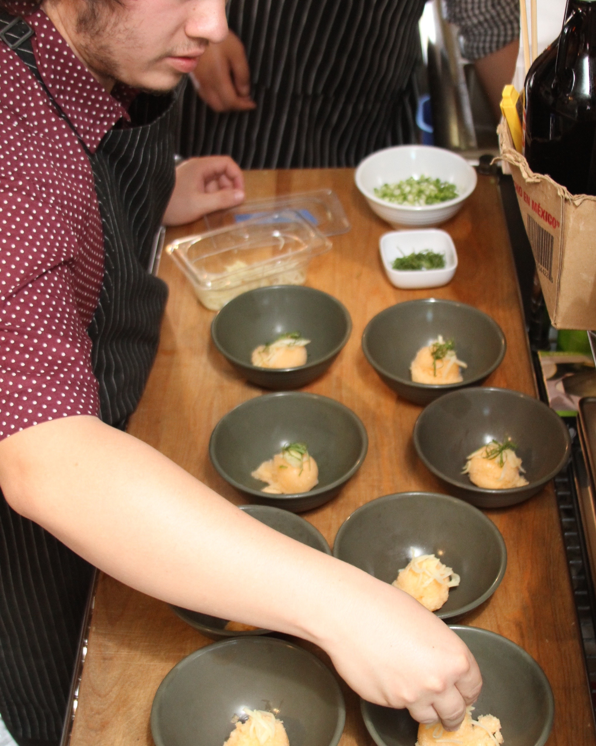 Garnishing the sorbet with mint