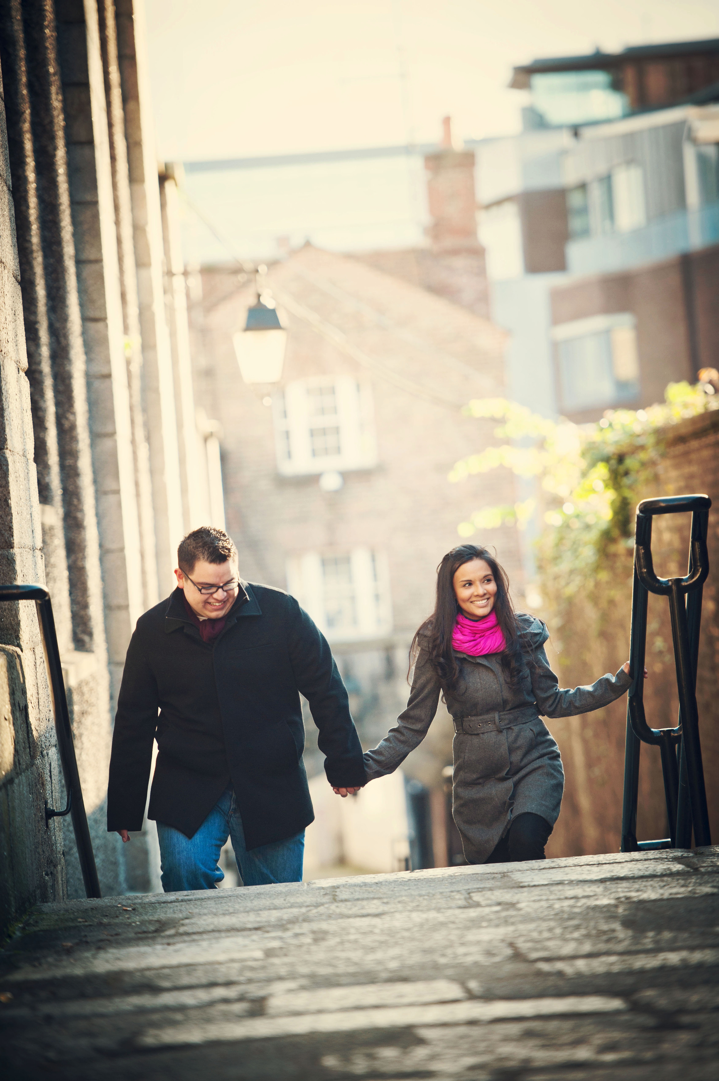 Valeria and Nestor strolling through Dublin City Centre during their engagement photo shoot by Weddings by KARA