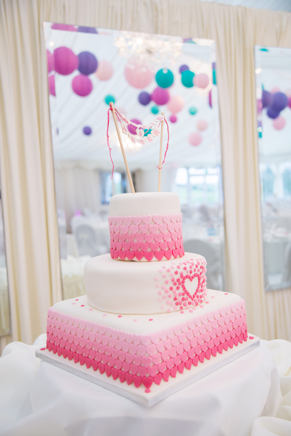 Pete 's Mum, Sandra Lindsay, made our awesome wedding cake...over three hundred hearts on it!