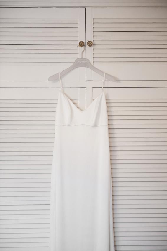 wedding dress against shutter wardrobe