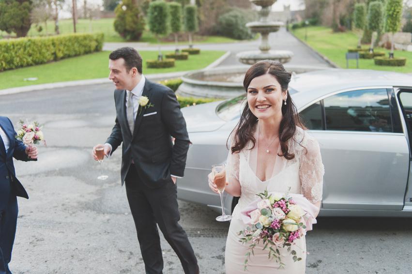 Bride and groom arriving at Bellingham Castle Hotel