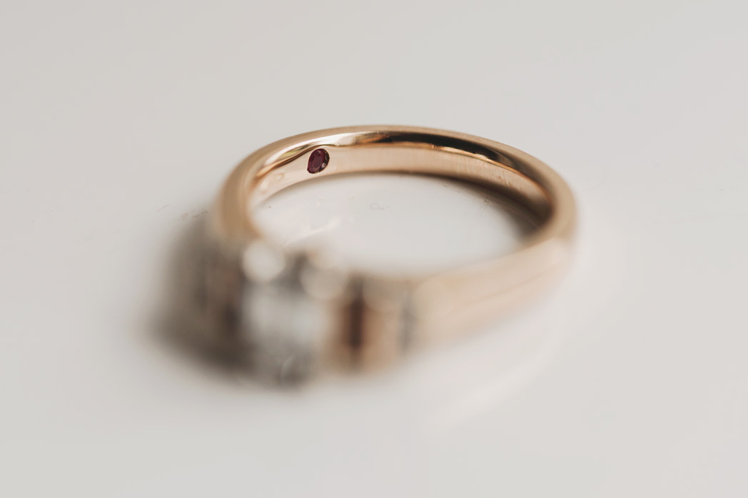 Secret ruby on engagement ring - wedding photography meath