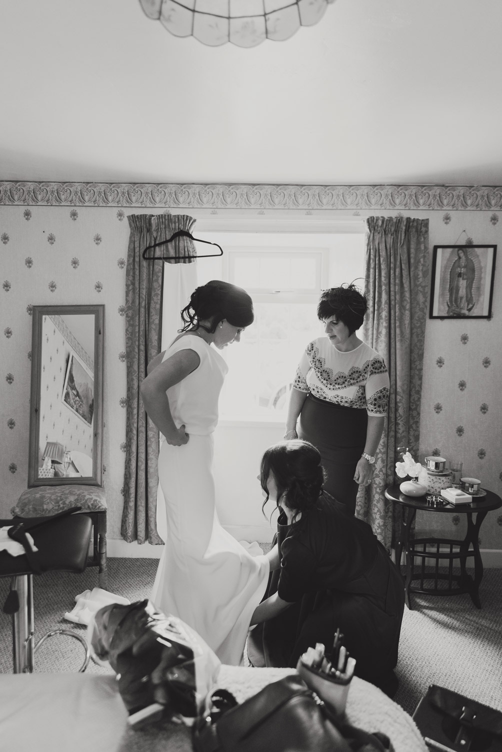 Bride getting dressed on morning of wedding. Photography meath ireland.