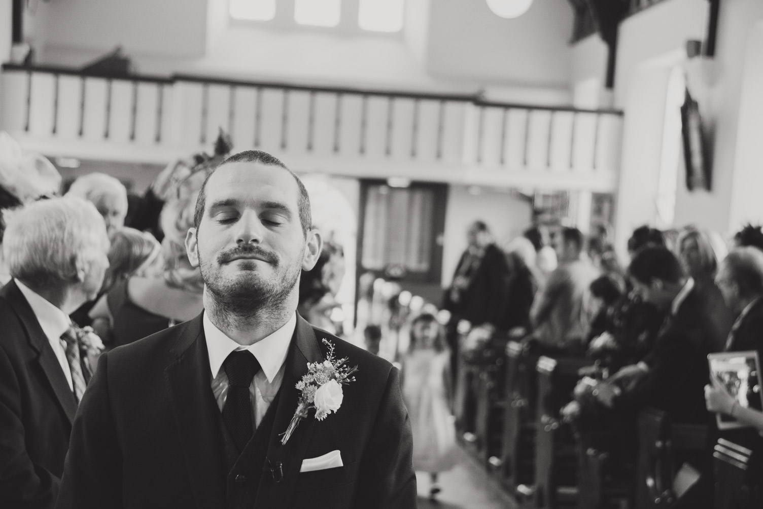 Groom waiting at the altar for bride in church ceremony. Wedding photography Co. Meath.