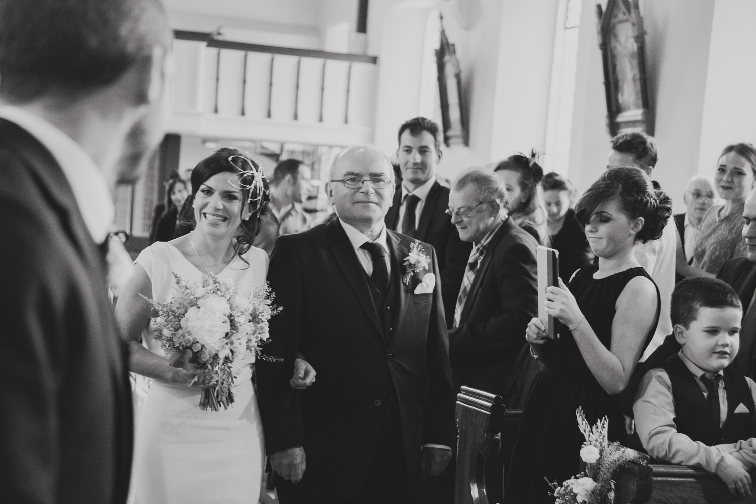 Bride walking up the aisle in church. Wedding photography meath.