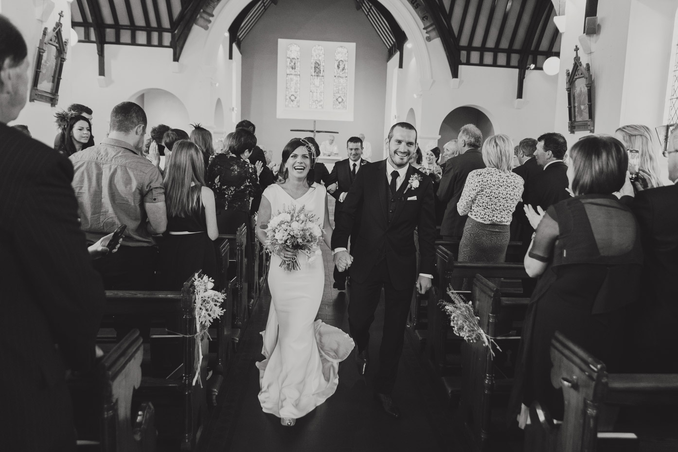 Bride and groom just married leaving church in meath. Ireland. Wedding photographers.