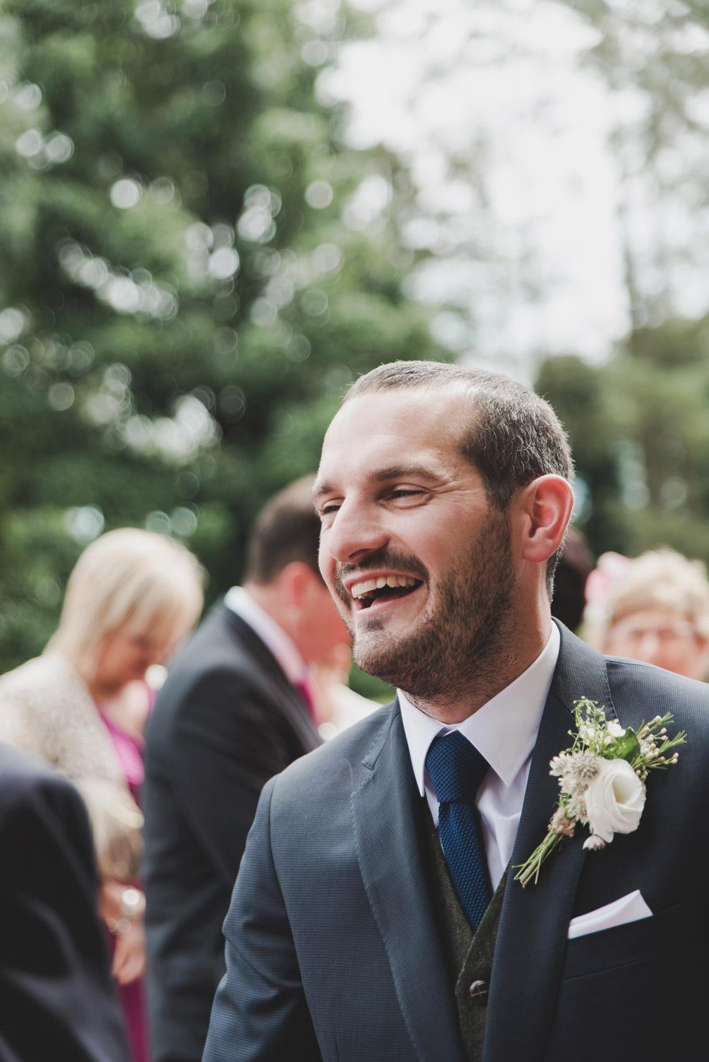 Groom laughing outside church. Wedding photographers meath.